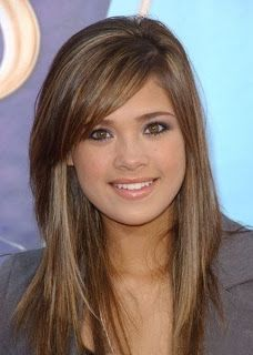 Nice side bangs and long layered haircut.  A cut that looks good without doing anything with it, but you could still do a lot with it if you wanted to.