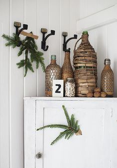 Wicker bottles, a beautiful little detail, I long to pick one of these bottles up and feel the textures and see if there is a hidden message inside. A sweet piece of whimsy #interiorstaging #interiorstyling #craft