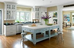 Exquisite kitchen island on casters in beautiful blue and white with ample storage - Decoist