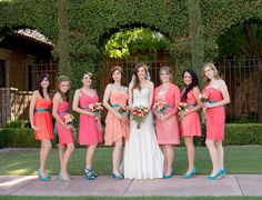Bridesmaids dressed in coral dresses and completing the outfit with aqua shoes | villasiena.cc