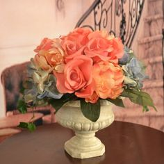"Peach Rose and Blue Hydrangea Silk Flower Bouquet AR357 - Greet your guests with this warm and delicate silk rose centerpiece. Delicate blue hydrangea offset the soft peach tones of roses and peonies. Vibrant greenery glows over a white pedestal vase, creating an exquisite faux flower arrangement that measures 12""H X 11""W X 11"" D. #silkflowers"