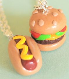"""Handmade Hot Dog and Cheeseburger Best Friend Necklaces by Pumpkin Pye. $39.99. Two lifelong companions: the cheeseburger and the hot dog. Which will you keep, and which will you give away? Either way, you're going to have an awesome necklace!  Keep one and give one to a friend. Each charm comes on a 16"""" silver plated necklace chain.  100% handmade from polymer clay in the USA by Pumpkin Pye.  Please keep in mind that no two handmade polymer clay pieces will ever be alike. This ..."""