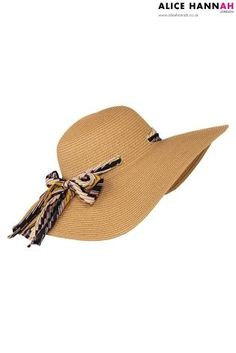 Floppy hats are SO on-trend this summer. It's the PERFECT accessory for any holiday outfit.