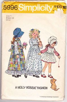 Hollie Hobbie Fashion Girls Dress Pinafore Bonnet Size 5 1970s Sewing Pattern Simplicity 5996 #HollieHobbie #HollieHobbieSewingPattern #HollieHobbieDress