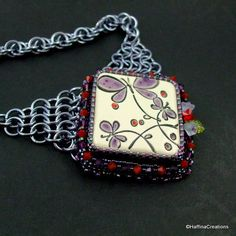 Peruzi Cabochon Bead Embroidered and Chainmaille Necklace. $115.00, via Etsy.