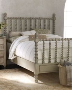 Quiet chic grey spindle bed with white bedding