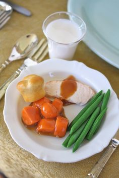 Thanksgiving Dinner #2   includes: turkey slice with gravy candied sweet potatoes green beans clover leaf roll milk