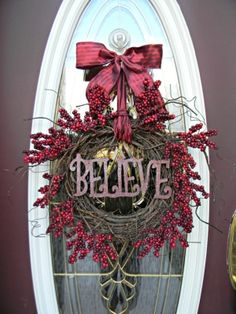 """this is a cute wreath. maybe with cream beads instead of red and maybe saying """"welcome"""""""