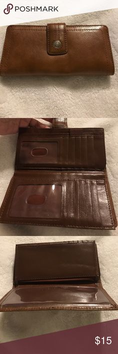 Fossil Wallet with checkbook cover. Brown wallet in great condition with checkbook. It is leather by Fossil. Fossil Bags Wallets