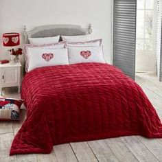 From the exclusive Jan Constantine range, this red bedspread has been designed with a square quilting pattern completed by hand and has been crafted from c. Red Bedspread, Cotton Velvet, Bed Spreads, Comforters, Blanket, Bedroom, Pattern, Collection, Home