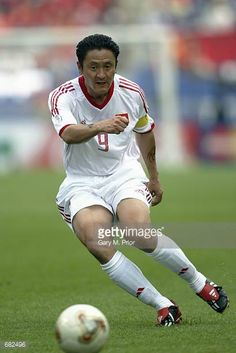 Mingyu Ma of China passes the ball during the FIFA World Cup Finals 2002 Group C match between China and Costa Rica played at the Gwangju World Cup...