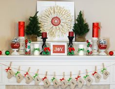 The classic Christmas colors -- red and green -- are displayed beautifully on this mantel. #decor #christmas
