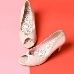 Walk just a little taller in these timeless kitten heels!