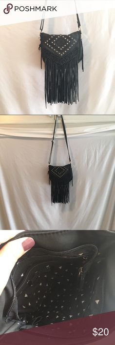 Mini Purse An Urban Outfitters mini side bag. Gold studs in front. Tassels hang in the front. Suede. Little zip pocket inside with two other pockets on the opposite side. Zips close. A zip pocket in the back. 10 inches long. 9 inches wide Urban Outfitters Bags Satchels