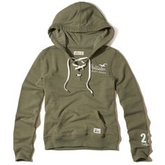 Hollister Lace-Up Graphic Hoodie ($40) ❤ liked on Polyvore featuring tops, hoodies, olive, lace up hooded sweatshirt, army green hoodie, olive top, laced hoodie and hooded pullover