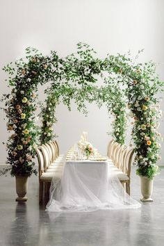 "From the editorial ""A Wedding Editorial Inspired by Art Nouveau Era Perfume Ads."" These photos get dreamier and dreamier as you browse through the full gallery, especially this epic floral arch that hovered over the reception! Photographer: @laceandluce #weddingreception #indoorwedding #floralarch #flowerarch #weddingflowers #floraldesign"