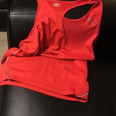 Red Puma Workout Tank Super lightweight red puma workout tank. Wonderful for working out in, since it's super light weight! Only worn about four times. No rips, stains, or holes. In wonderful condition! Puma Tops Tank Tops