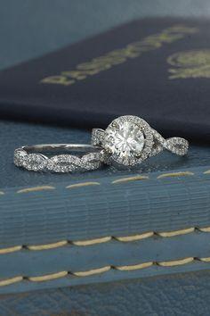 Halo infinity diamond engagement ring alongside round diamond twisted infinity wedding band || @shanecompany #ShaneCo