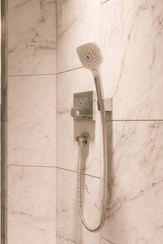 Come for the large marble tile; stay for water droplets delivered with more power for a more relaxing shower. Our Square Handshower is WaterSense high-efficiency certified to help conserve resources. Shower Nozzle, Shower Hose, Sewage System, Water Efficiency, Water Droplets, Save Water, Shower Heads, Showers, Tile