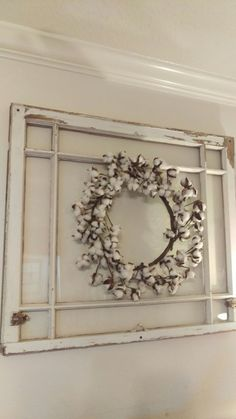 Antique window from demolished home in Montrose built in 1947. Found cotton boll wreath to order online.