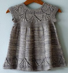 Precious knitted baby dress. Clara pattern by Karin Vestergaard Mathiesen, knit by Alicia Paulson.