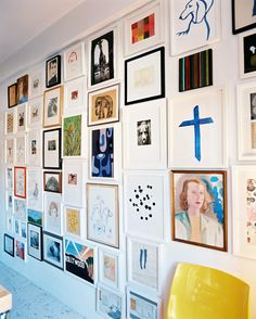 A floor-to-ceiling gallery wall of all shapes, sizes, and colors.