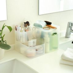 Muji storage boxes for the bathroom. Makes it easier to keep the bathroom dust-free.