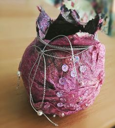 Handmade pomegranate lucky charm from recycled newspaper