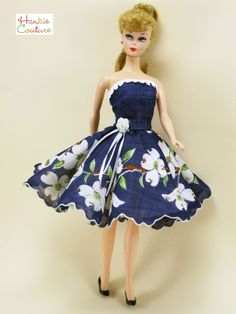 "TWO vintage items have become this OOAK doll outfit!  Navy-blue hankie is now a fully-lined dress, with a circular skirt of white dogwood blooms!  Strapless bodice has crochet trim to match the jacket.  A vintage linen-hankie is now a jacket with long sleeves.  It fits 11 1/2"" Barbie, the custom designed Hankie Couture doll, and similar-sized dolls! Sold on eBay for $30 in March 2015 #HankieCouture #doll #hanky #blue #dogwood #jacket"