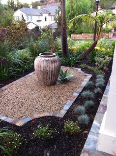 Fine Gardening Article on replacing lawn with plants and permeable hardscape.