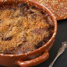 Cassoulet is a French dish. It's a slow-cooked combination of of beans, pork sausages, pork shoulder, pancetta, duck, a number of spices, and a dusting of bread crumbs. We recommend Maison du Cassoulet in Castelnaudary, France.