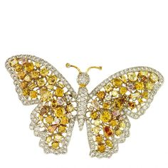 Butterfly brooch in platinum with natural color diamonds by Amgad, New York