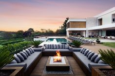 In this contemporary exterior lounge at condo residence in Brazil, the designer used an ecological fire pit by Construflama. The negative edge pool blends with the landscape, and plants such as bamboo and trees offer privacy and maximize the view. The project by designer Alex Hanazaki won a 2014 American Society of Landscape Architects award.