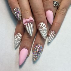 Pretty Pink bow and rhinestones on stiletto nails