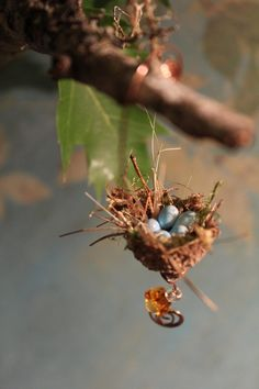 Fairy garden miniature acorn bird's nest with amber colored glass flower bead. $6.99, via Etsy.