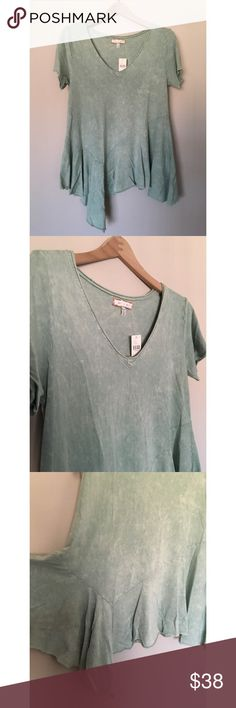 Mint Asymmetrical Vneck Brand new with tags mint washed Asymmetrical short sleeved top from Anthropologie. Swing fit with ruffled bottom. Looks super cute with distressed denim and ankle booties. Size XS. Please see measurements for better fit.  Measurements laying flat:  Bust: 17 inches Waist: 18 inches Length (shortest): 23 inches Length (longest): 33 inches Anthropologie Tops Tees - Short Sleeve