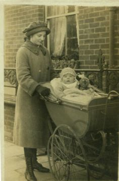 Real photo postcard of young woman with baby circa 1910.
