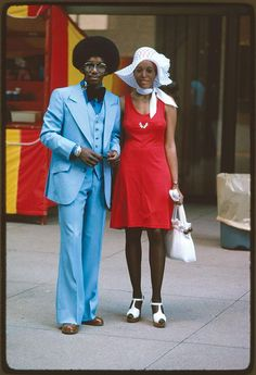 A couple on the street on Michigan Avenue, Chicago photographed by Perry Riddle in July 1975
