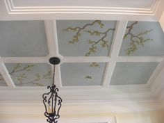 Hand painted mural on a ceiling in a foyer.