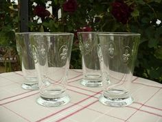 made by la rochere, these fleur de lys glasses are stunning, i have some different patterned ones. they are very heavy and solid! love these ;o)