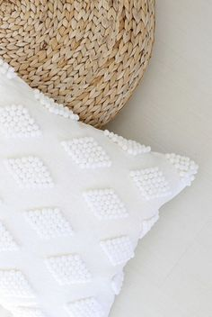 Glue pompoms to a pillowcase to add texture.