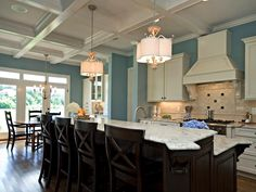 I love the coffered ceiling and the blue on the walls. I think the blue would look lovely as a wash on a beadboard-clad island.