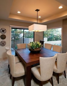 square table, dropped ceiling, ugly wall decorations tho #diningroom