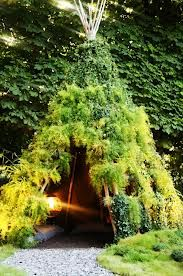 I have always wanted to try doing this. Teepee made of Bamboo pole covered in vines. Many beans have beautiful blooms that would look great.