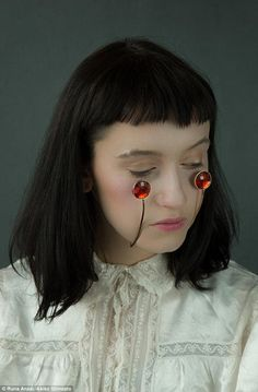 'Another Skin' Red jewels below the eyes look delicate but make the wearer appear to crying rubies | avant-gard jewelry design