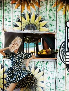 A beach cabana, print dress & straw hat, in Brazil | Karlie Kloss by Mario Testino for Vogue