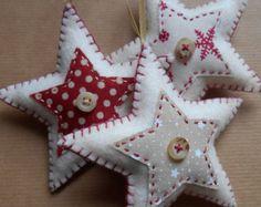 Set of three star-shaped felt christmas decorations, handmade to order.