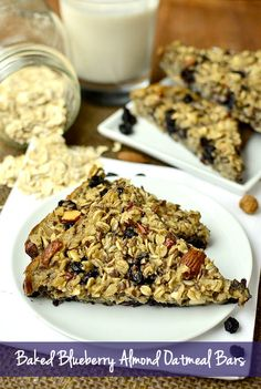 Baked Blueberry Almond Oatmeal Bars are soft, muffin-like, and packed with good for you ingredients like almonds, oats, and dried blueberries. | iowagirleats.com