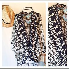 Get your KIMONO here!! This is a beautiful kimono. It is a size small but could easily fit a medium size as well. It has been worn several times but is in perfect condition. The pattern has a mauve and gold color mixed in with the black and cream. Tops