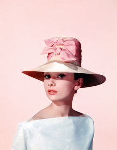 Audrey Hepburn in a publicity photo for Funny Face, 1957 -- I want that lovely double ribbon hat!